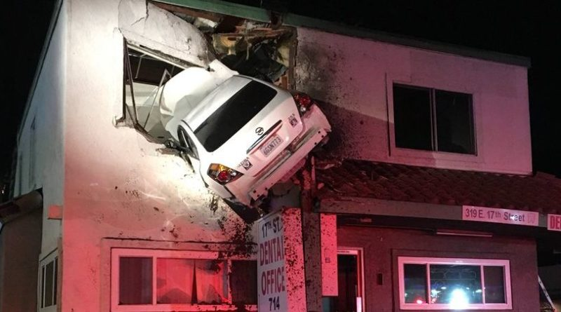 Car crashing though second story of building